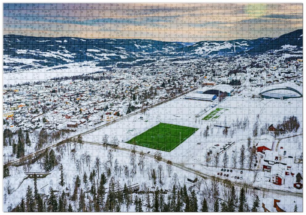 Puzzle: Grüne Oase in der Schneelandschaft von Lillehammer