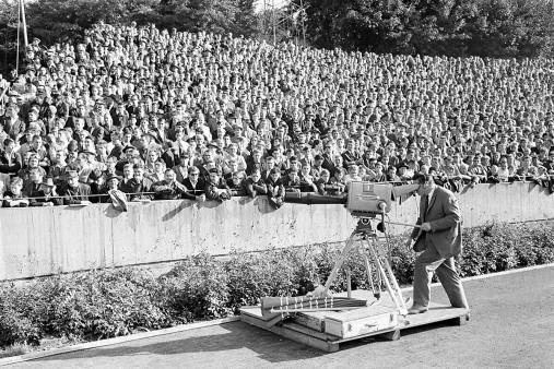 Kameramann vor Zuschauern